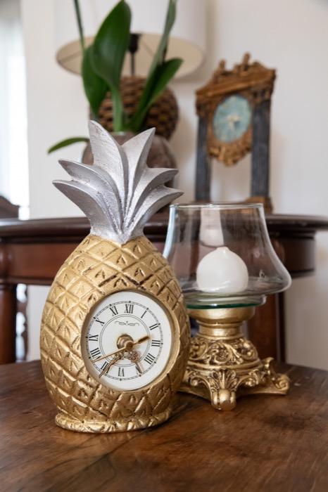 relógio abacaxi e castiçal ou baleiro